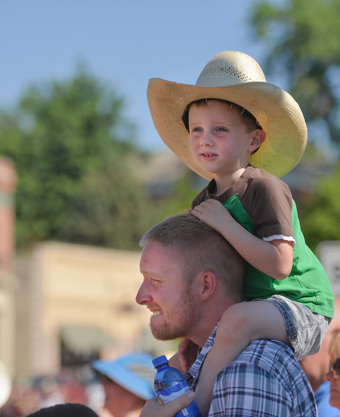 Justin Sheely | The Sheridan Press <br /> Four-year-old Jude Mason and Josh Mason of Helena, Montana, watch the parade during the sixth annual Longmire Days Saturday on Main Street in Buffalo, Wyoming. The show is based on local author Craig Johnson's novels set in the fictional town of Durant, inspired by the town of Buffalo. Longmire's sixth and final season will be on Netflix sometime this year.