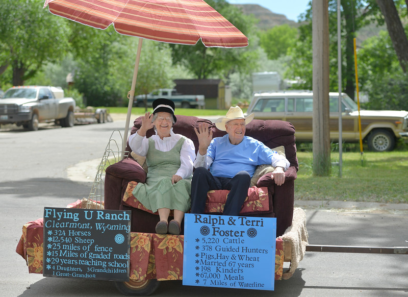 Justin Sheely | The Sheridan Press<br /> Longtime Clearmont ranchers Terri Foster and Ralph Foster wave from a float in the parade during the 125 year anniversary celebration of the town of Clearmont Saturday. The town was founded in 1892 as the railroad was established through the Clear Creek Valley. The town reached its peak in the 1950s with a population of 225.