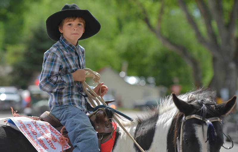 Justin Sheely | The Sheridan Press<br /> Seven-year-old William Mediate waits on his mount prior to the parade during the 125 year anniversary celebration of the town of Clearmont Saturday. The town was founded in 1892 as the railroad was established through the Clear Creek Valley. The town reached its peak in the 1950s with a population of 225.