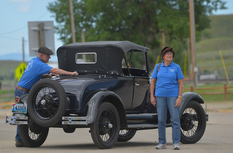 Justin Sheely | The Sheridan Press<br /> Gary Bergman and LaDonna Bergman lock up their 1929 Model A Roadster after the parade during the 125 year anniversary celebration of the town of Clearmont Saturday. The town was founded in 1892 as the railroad was established through the Clear Creek Valley. The town reached its peak in the 1950s with a population of 225.