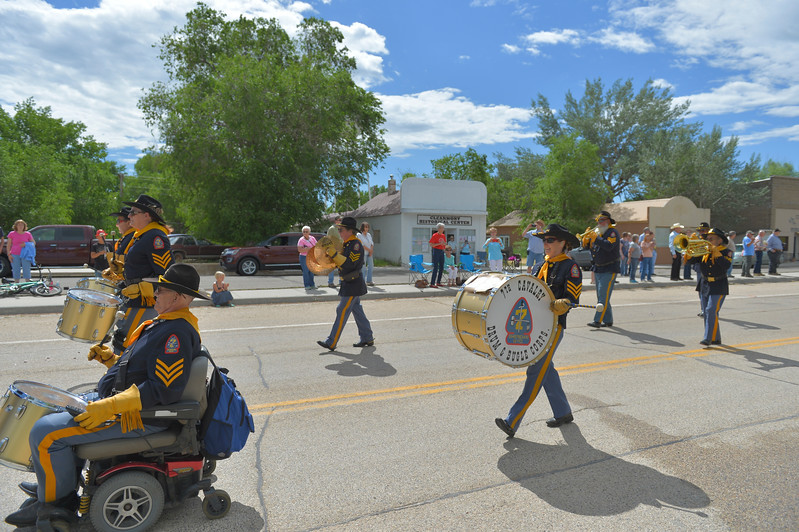 Justin Sheely | The Sheridan Press<br /> The Drum and Bugle Corps marches in the parade during the 125 year anniversary celebration of the town of Clearmont Saturday. The town was founded in 1892 as the railroad was established through the Clear Creek Valley. The town reached its peak in the 1950s with a population of 225.