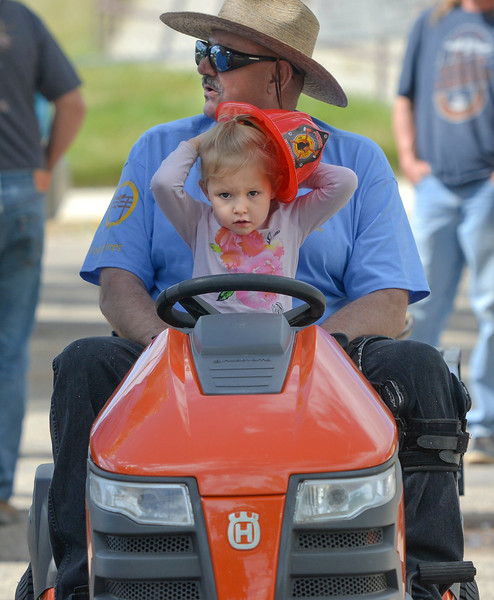 Justin Sheely | The Sheridan Press<br /> Three-year-old Annaliese Haynes catches her hat as John Kiser visits with others prior to the parade during the 125 year anniversary celebration of the town of Clearmont Saturday. The town was founded in 1892 as the railroad was established through the Clear Creek Valley. The town reached its peak in the 1950s with a population of 225.