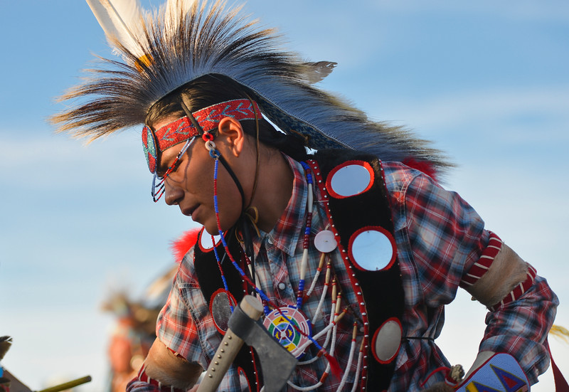 "Justin Sheely | The Sheridan Press<br /> A dancer competes during the grand entry powwow Saturday evening during Crow Fair at Crow Agency, Montana. Crow Fair started in 1904 and is currently the largest gathering of Native Americans of the great plains tribes. The week-long celebration includes parades, powwow dance competitions and rodeo. For crow native Alma McCormick of Hardin, Montana, Crow Fair is an important way of preserving the culture of the Apsaalooke – people of the large-beaked bird – and acts as a family reunion of sorts for relatives living out of the reservation or out of state. It is also an event where Crow children hear their native language used, ""Your language is your culture,"" said McCormick, who has a three-year-old granddaughter who's already showing interest in the dancing. Year after year Crow Fair has imparted the cultural heritage and language of the plains tribes onto the next generation."