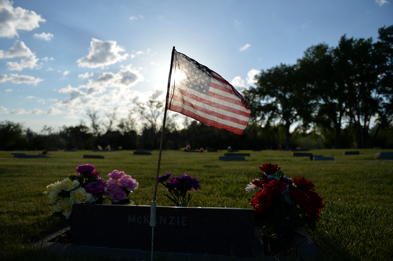 Justin Sheely | The Sheridan Press<br /> A flag is set over the grave of a service member during morning decorating on Memorial Day at the Sheridan Municipal Cemetery. Members of the American Legion Post #7, Veterans of Foreign Wars, Disabled Veterans and community members decorated the headstones of veterans with flags.