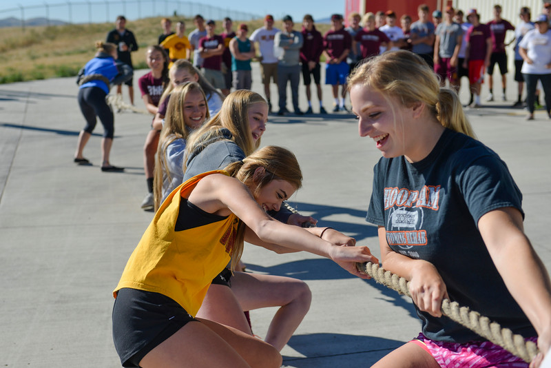 Justin Sheely | The Sheridan Press<br /> Teammates Alisyn Hutton, left, and Abby Buckingham pull with the Big Horn volleyball team during the inaugural fire truck pull Saturday at Goose Valley Fire Station. Members of the volunteer fire department competed against athletes from Big Horn High School football and volleyball teams to see which group could pull the 6400-pound fire engine fifteen feet in the shortest time. The firefighters beat the football team after pulling the truck in only 10.2 seconds – Rams' time was 12.25 seconds. The fire truck pull benefits the Wyoming Special Olympics and the torch run.