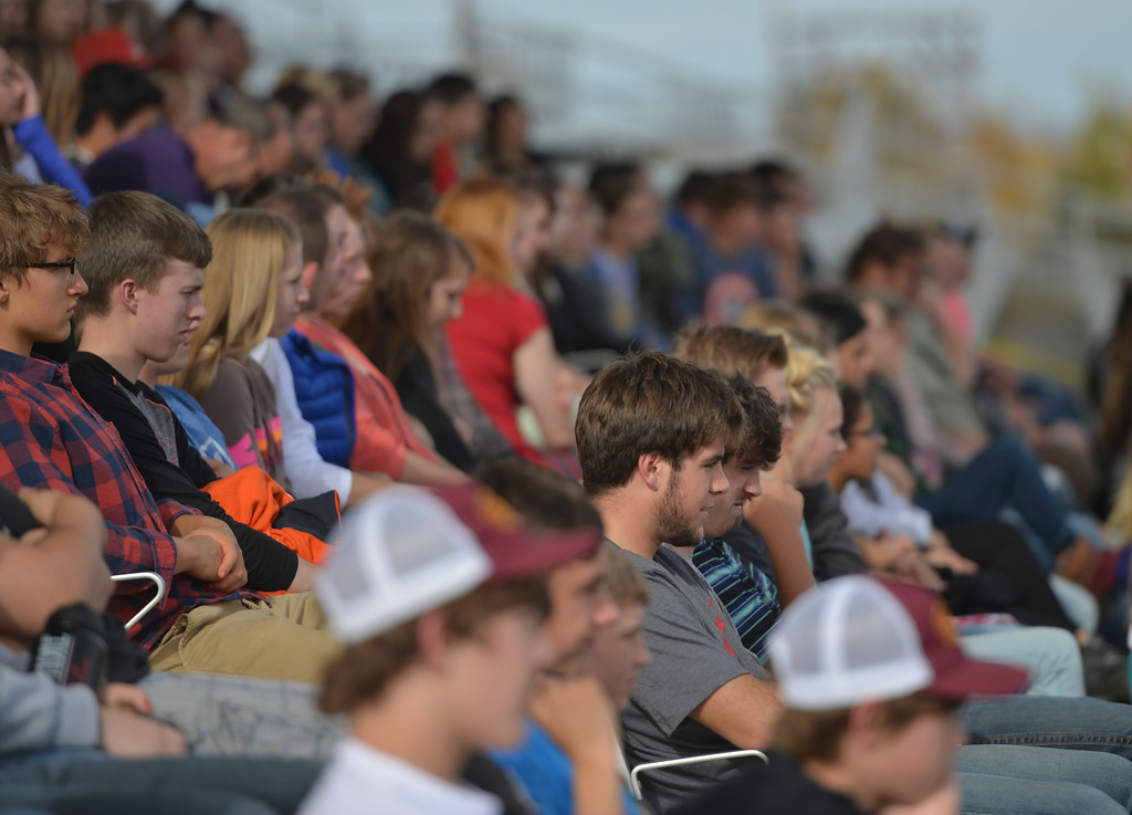 Justin Sheely | The Sheridan Press<br /> Big Horn and Tongue River High School students watch as first responders arrive at the crash scene during the Last Call Demonstration Wednesday at the Sheridan County Fairgrounds. Tongue River seniors Sierra McCoy and Kylee Knobloch organized the demonstration for their FCCLA project. Students from Big Horn and Tongue River high schools participated in role playing a scenario of students driving after an underage drinking party collides head-on with another vehicle full of students returning home from a day hiking in the Tongue River Canyon. The scenario graphically demonstrates the consequences of drunken and distracted driving. Sheridan Fire-Rescue helped organized the demonstration. Agencies in the demonstration included Sheridan County Sheriff's Office, Big Horn and Tongue River Fire Districts, Rocky Mountain Ambulance, Sheridan Police Department and Wyoming Highway Patrol.