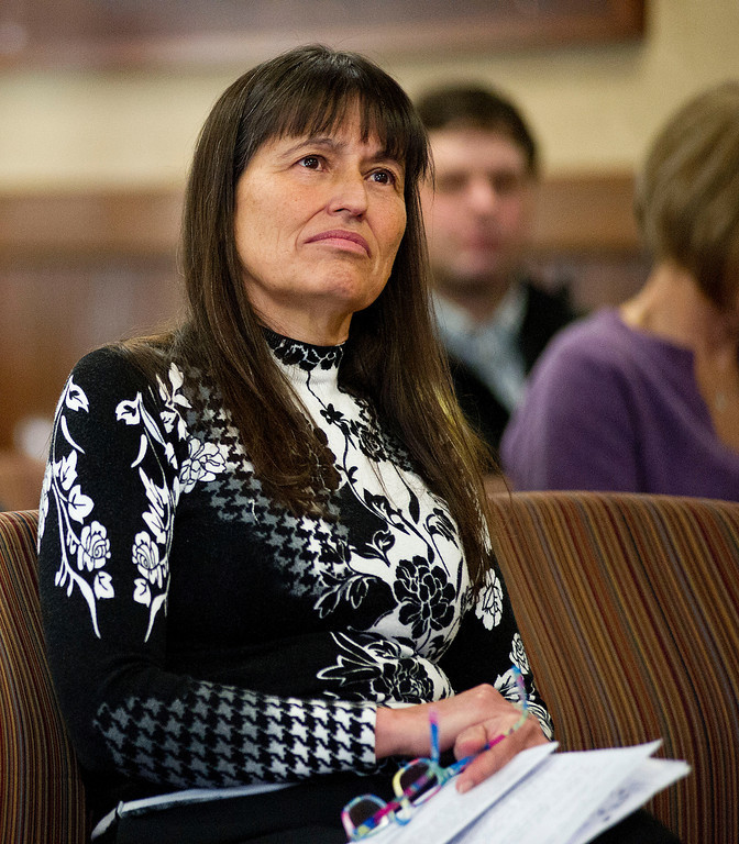 Charitina Fritzler, Executive Director of the First Peoples Center for Education, watches the Arapaho tribal liaison speak before the delegation during the Legislative Forum Thursday morning at City Hall. (The Sheridan Press/Justin Sheely)