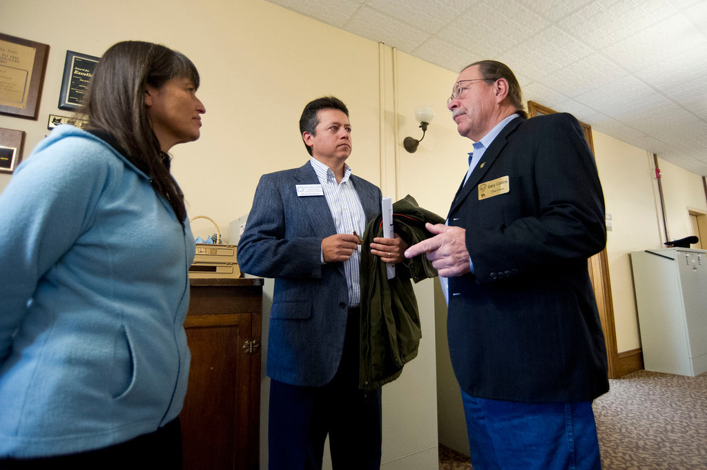 From left, Charitina Fritzler and Rod Trahan of the First People Center for Education talk visit outside the chamber room with Northern Arapaho Tribe Liaison Gary Collins after their presentation in the Legislative Forum Thursday at City Hall. (The Sheridan Press/Justin Sheely)