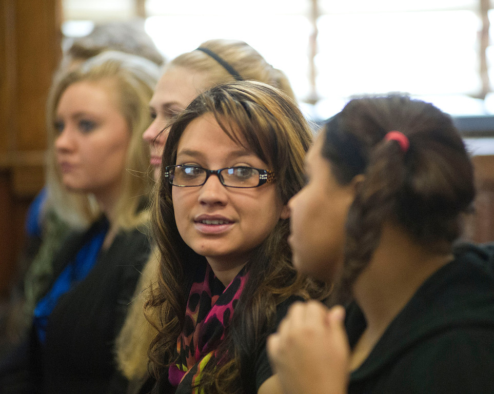 Arvada-Clearmont senior Shantel Armijo whispers to a classmate during the Legislative Forum Wednesday in the City Hall Chamber room. (The Sheridan Press/Justin Sheely)