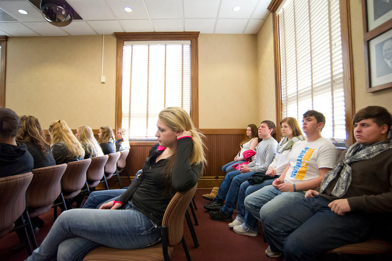 Arvada-Clearmont High School juniors KayLee Stidham, left, and Ian Voiles, far right, listens as the School District 3 Superintendent speaks during Wednesday's Legislative Forum in the City Hall Chamber room. (The Sheridan Press/Justin Sheely)