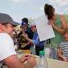 Actor Bailey Chase, left, visits with Buffalo residents Melodie Gross, middle, and her daughter Alaina, 8, after signing a Longmire poster for them Saturday at the Crazy Woman Square in Buffalo.