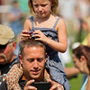"Mia Schurtz, 5, sits on her dad Kasey's shoulders as she gets a picture of actress Katee Sackhoff in ""Longmire"" Saturday at the Crazy Woman Square in Buffalo."