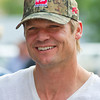 "Actor Bailey Chase, who plays Branch Connally in the hit cable show ""Longmire,"" heads to the autograph table during Longmire Days at the Crazy Woman Square in Buffalo."