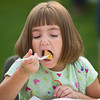 Rachel Noonan, 5, of Buffalo takes a bite of her pancake at the Kiwanis Pancake Breakfast during Longmire Days Saturday at Crazy Woman Square in Buffalo.