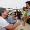 Bailey Chase (Branch Connally), left, signs a book for Carol Wierling of Cheyenne during Longmire Days at Crazy Woman Square in Buffalo.