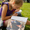 Amanda Kapphan, 10, sits in line as she reads a Cowboy & Indians magazine feature of Longmire cast member Bailey Chase during Longmire Days Saturday at Crazy Woman Square in Buffalo.