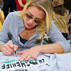 Actress Katee Sackhoff (Vic Moretti) signs a shirt during Longmire Days Saturday at Crazy Woman Square in Buffalo.