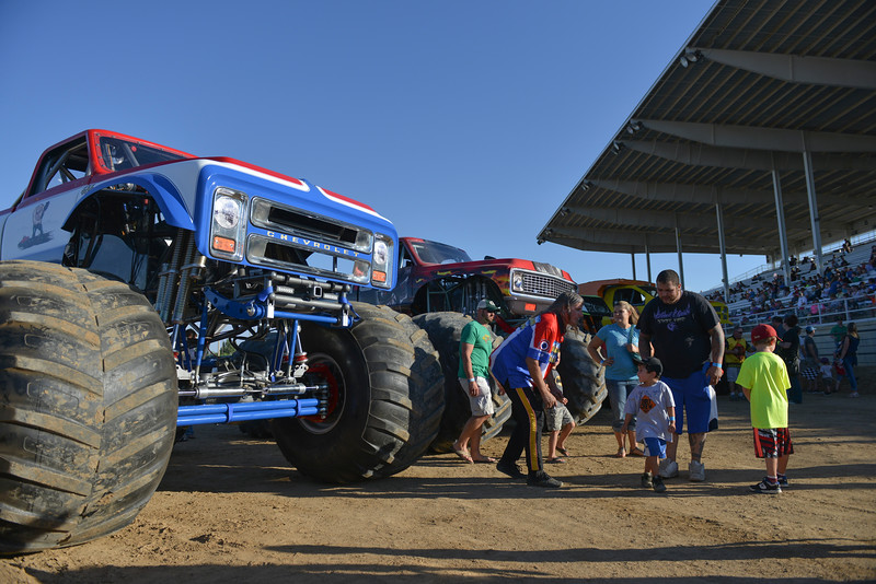 Justin Sheely | The Sheridan Press<br /> A monster truck fans visit monster truck drivers and receive autographs for the VIP pit stop event prior to the Mega Promotions Monster Truck show Saturday at the Sheridan County Fairgrounds.