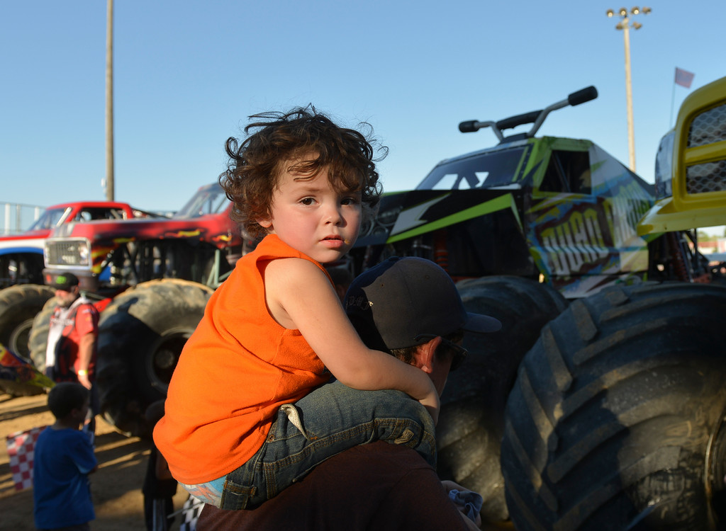Justin Sheely | The Sheridan Press<br /> Two-year-old Dayton Morley rides his father Jeremiah Moreley's shoulders as they wait for an autograph for the VIP pit stop event prior to the Mega Promotions Monster Truck show last July at the Sheridan County Fairgrounds.