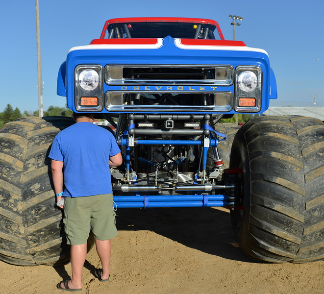 Justin Sheely | The Sheridan Press<br /> A monster truck fan checks out the Cyclops monster truck for the VIP pit stop event prior to the Mega Promotions Monster Truck show Saturday at the Sheridan County Fairgrounds.