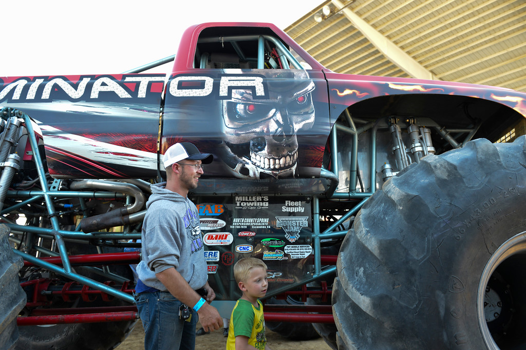 Justin Sheely | The Sheridan Press<br /> Ben Mumm and son Dana Mumm, 5, explore the Terminator monster truck for the VIP pit stop event prior to the Mega Promotions Monster Truck show Saturday at the Sheridan County Fairgrounds.