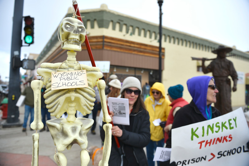 Justin Sheely | The Sheridan Press<br /> Molly Dow holds a toy skeleton representing public schools during the protest against state legislation Saturday on Main Street in Sheridan. The protest was organized by members of Real Resistance Wyoming in response to Senate Joint Resolution SJ0009, co-sponsored by Sen. Dave Kinskey, R-Sheridan, which proposes an amendment that would prohibit the courts to rule on funding for public schools beyond what the legislature would determine necessary. The amendment is seen by the protestors as a threat to funding for Wyoming's public education.