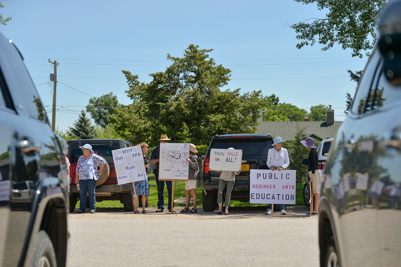 Justin Sheely   The Sheridan Press<br /> Protesters gather across the street from the meeting place of the Republican Women of Sheridan County scholarship fundraiser Thursday at the Big Horn Smokehouse in Big Horn. Real Resistance Wyoming of Sheridan organized the protest against U.S. Rep. Liz Cheney, R-Wyoming, and government cuts to the Environmental Protection Agency. Cheney came to speak at the fundraiser, which provides scholarships to local women republican college students.