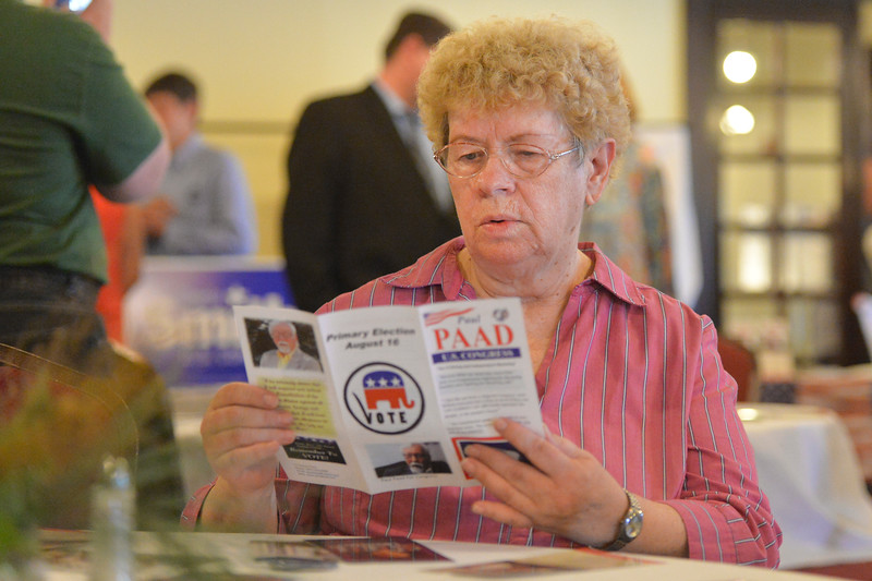 Justin Sheely | The Sheridan Press<br /> Attendee Barb Arbogast reads a pamphlet during the congressional meet and greet for Republican candidates for Wyoming's lone U.S. House seat Tuesday night at the Historic Sheridan Inn. The event was organized by the Republican Women of Sheridan County and the Sheridan County Republican Party. Attendees got to listen to eight out of the nine republicans running for U.S. Rep Cynthia Lummis' seat.