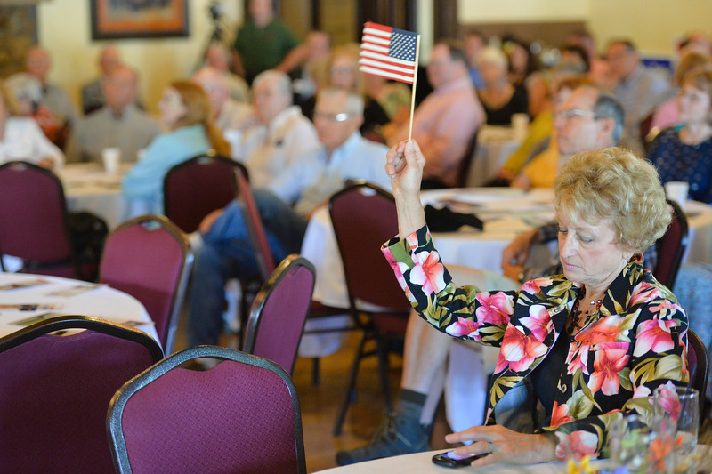 Justin Sheely | The Sheridan Press<br /> Time keeper Carla Klopfenstein waves a flag to signal the one minute warning as a candidate speaks during the congressional meet and greet for Republican candidates for Wyoming's lone U.S. House seat Tuesday night at the Historic Sheridan Inn. The event was organized by the Republican Women of Sheridan County and the Sheridan County Republican Party. Attendees got to listen to eight out of the nine republicans running for U.S. Rep Cynthia Lummis' seat.
