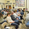 Audience members await the SCSD3 board's decision Wednesday night in Clearmont. The Sheridan County School District 3 school board denied a petition that requested its March 15 decision to not renew Arvada-Clearmont principal Christy Wright's contract to be recinded.