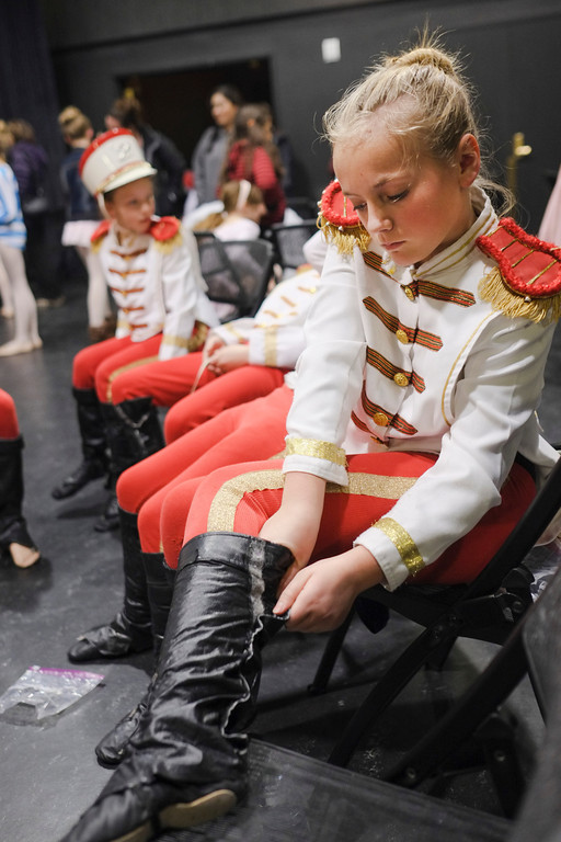 Eleven-year--old Ainsli Buchanan adjusts her boot during costume fitting Friday night at the WYO Theater. Dozens of local children played roles in the San Diego Ballet's Nutcracker performance in Sheridan over the weekend. Justin Sheely / The Sheridan Press.