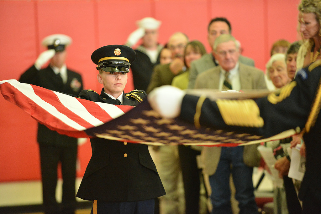 Sargent Eutsler of the Army National Guard in Wyoming holds performs the folding of the flag with members of the Army and Navy during the Celebration of Life service of Sen. John Schiffer, R–Kaycee, at the Kaycee High School gymnasium in Kaycee, Wyo. Attendance for the service contained a mix of family, friends, neighbors, colleagues, politicians, and other dignitaries. Sen. John Schiffer died last week at age 68 from liver cancer. The Sheridan Press|Justin Sheely.