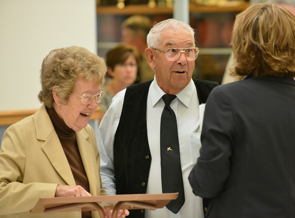 Dorothy Cash and Raymond Cash sign the guest list as they enter the lobby area for the Celebration of Life service of Sen. John Schiffer, R–Kaycee, at the Kaycee High School gymnasium in Kaycee, Wyo. The Cash's are neighbors with the Shiffer's at their ranch in Kaycee. Attendance for the service contained a mix of family, friends, neighbors, colleagues, politicians, and other dignitaries. Sen. John Schiffer died last week at age 68 from liver cancer. The Sheridan Press|Justin Sheely.
