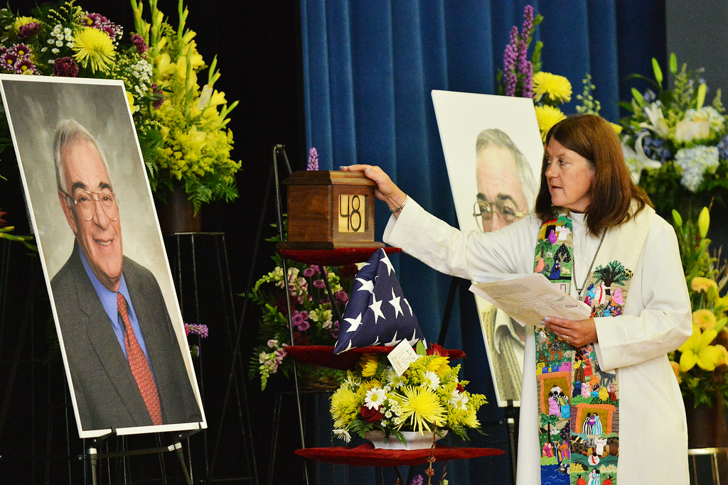 Rev. Carole Buckingham prays over the urn of the ash remains of John Schiffer during the Celebration of Life service of Sen. John Schiffer, R–Kaycee, at the Kaycee High School gymnasium in Kaycee, Wyo. Attendance for the service contained a mix of family, friends, neighbors, colleagues, politicians, and other dignitaries. Sen. John Schiffer died last week at age 68 from liver cancer. The Sheridan Press|Justin Sheely.