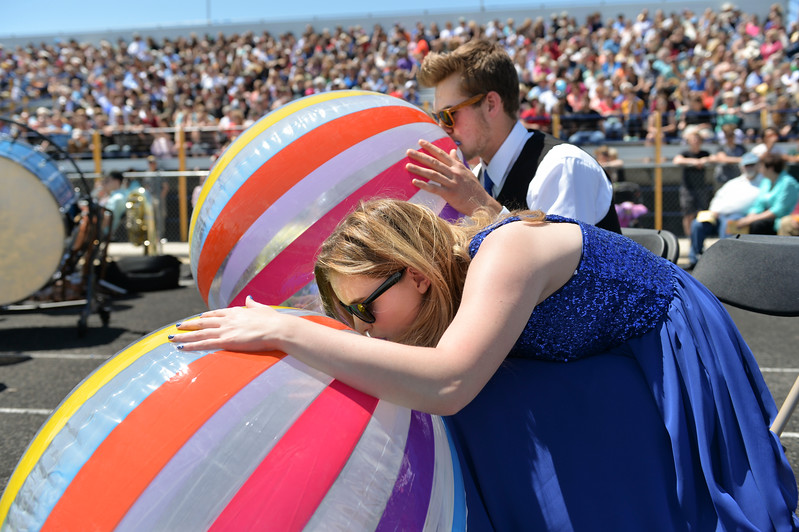 Justin Sheely | The Sheridan Press<br /> Choir members Quinton Brooks, back, and Logen Livingston inflate beach balls during the 2017 graduation ceremony Saturday at Sheridan High School.