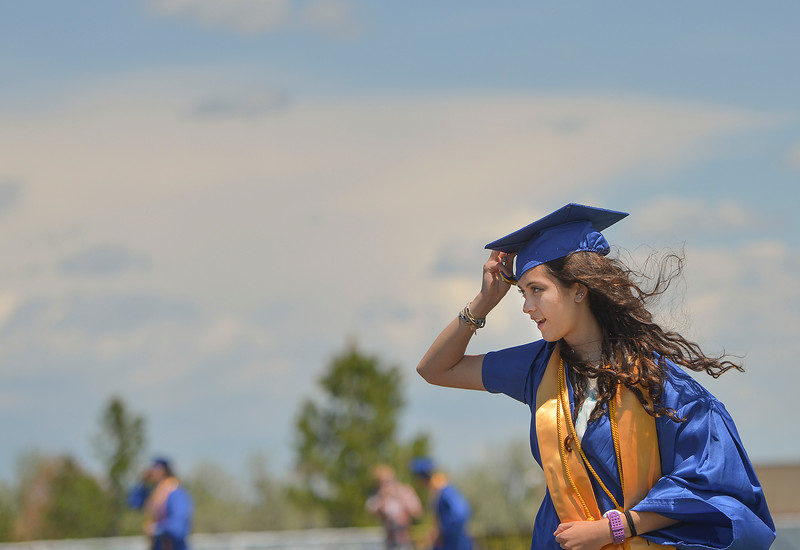 Justin Sheely | The Sheridan Press<br /> Xiomara Robinson marches across Homer Scott Field during the 2017 graduation ceremony Saturday at Sheridan High School.