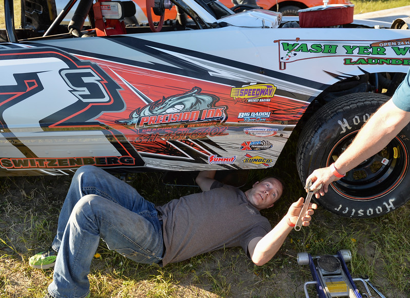 Justin Sheely | The Sheridan Press<br /> Chad Switzenberg changes the oil from his IMCA hobby stock car in the track pit during the opening race day for the season Friday at Sheridan Speedway. Dirt track racing is has been a long-held favorite summer activity for Sheridan spectators, drivers and organizers. The site reopened in spring of 2015 after being vacant for five years. This month's racing schedule is set on Friday, May 12 and 19, and Thursday, May 25.