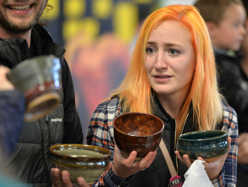 "Justin Sheely | The Sheridan Press<br /> Erin Kensey is faced with a dilemma as she tries to choose her favorite bowl during the ""Filling and Empty Bowl"" VOA soup fundraiser at the Sheridan County Fairgrounds Exhibit Hall. The annual event supports homeless services in Sheridan operated by Volunteers of America of the Northern Rockies."