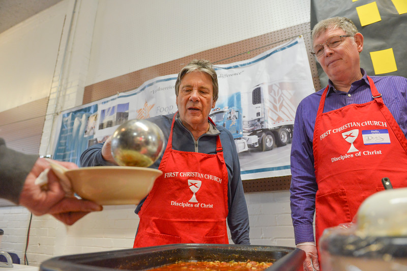 "Justin Sheely | The Sheridan Press<br /> Ron Kensey, left, and Doug Goodwin serve a guest during the ""Filling and Empty Bowl"" VOA soup fundraiser at the Sheridan County Fairgrounds Exhibit Hall. The annual event supports homeless services in Sheridan operated by Volunteers of America of the Northern Rockies."