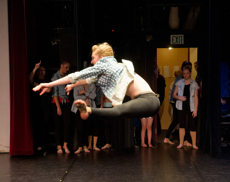 Dancers watch backstage as Cheyenne Buyert makes a leap during the closing performance.