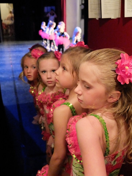 """Young dancers wait near the stage exit for their turn to perform """"Hawaiian Rollercoaster Ride"""" for the Annual Dance Recital presented by Studio 48 Friday night at the WYO Theater. From front to back, Kaylee Chase, Allana Bickel, Ahnya Ivie, and Isabel Reinke."""