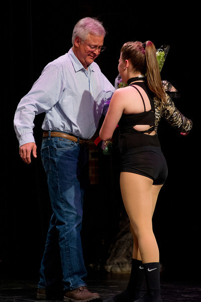"""Jim Kelly gives flowers to his daughter Laura Kelly, a graduating senior, after her solo performance of """"Lady Killer"""" Friday night at the WYO Theater."""