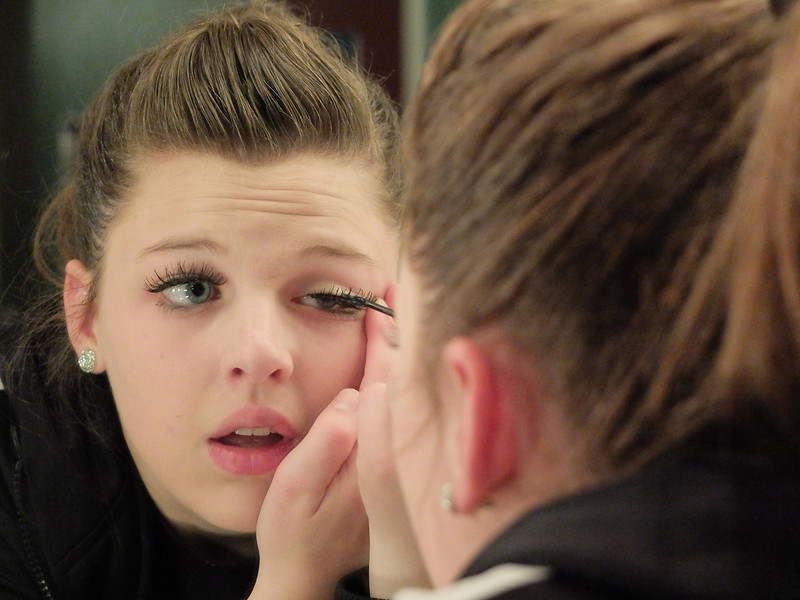 Laura Kelly applies makeup in the dressing room before the performance Friday night at the Sheridan WYO Theater.