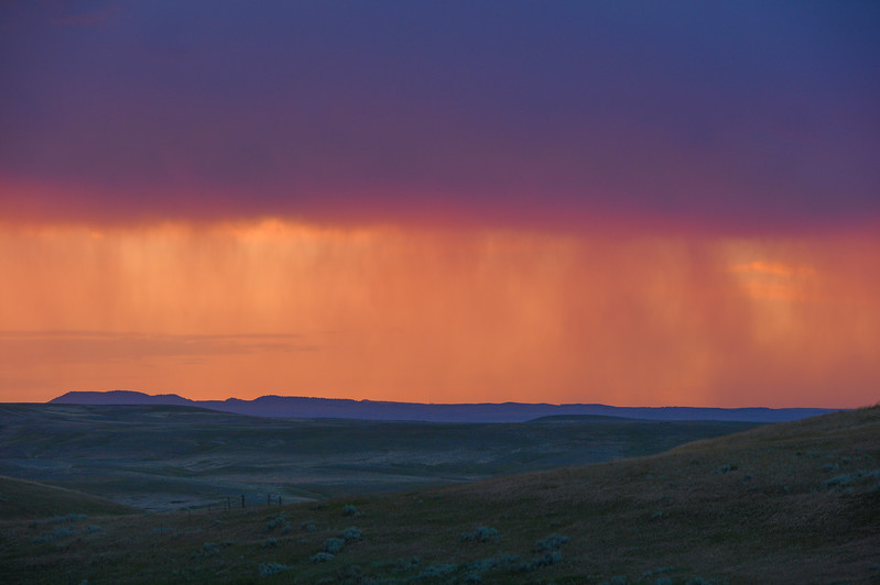 Justin Sheely | The Sheridan Press<br /> Rain bands are seen during a sunset near Sheridan July 6, 2017.