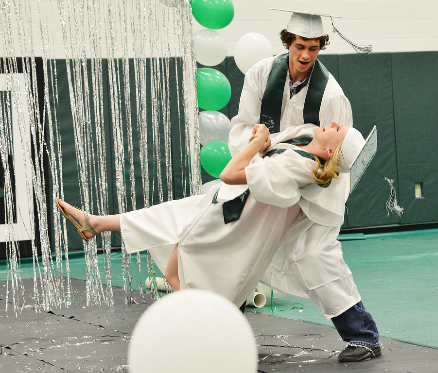 Chase Linhart and Kendal Bilodeau perform a brief unscheduled dance during the grand entrance during the 2014 Graduation Ceremony Sunday at Tongue River High School.