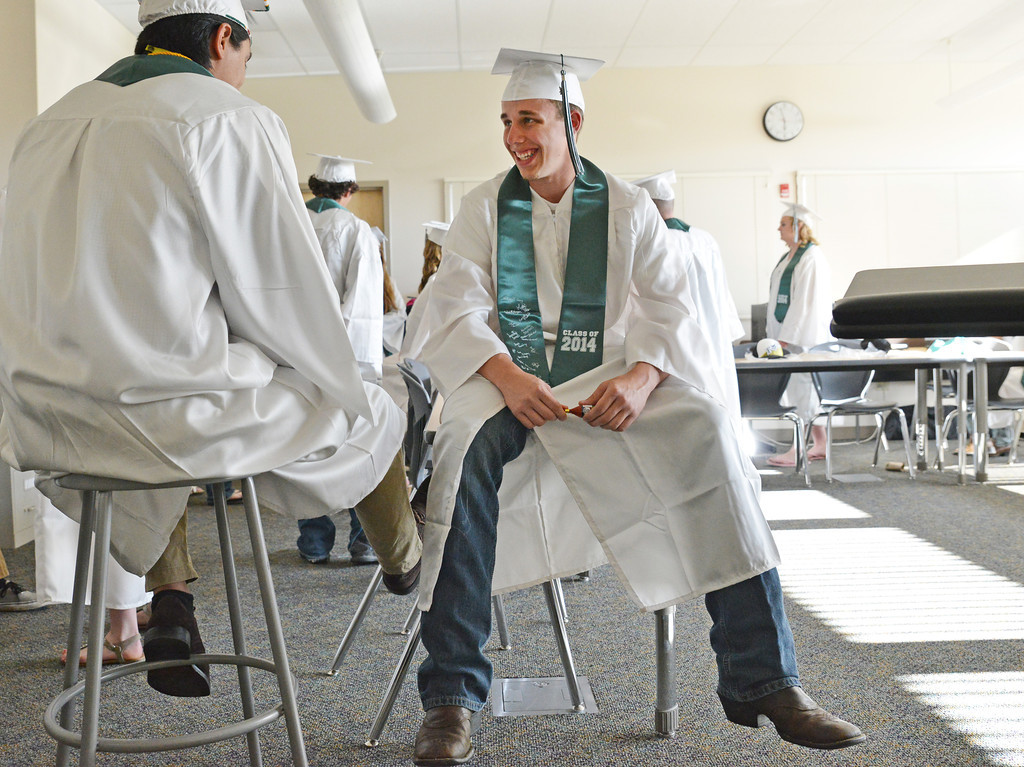 Matthew Burchell, right, passes time by talking with another graduate as the class of 2014 waits in a classroom before the graduating ceremonies Sunday at Tongue River High School in Dayton.