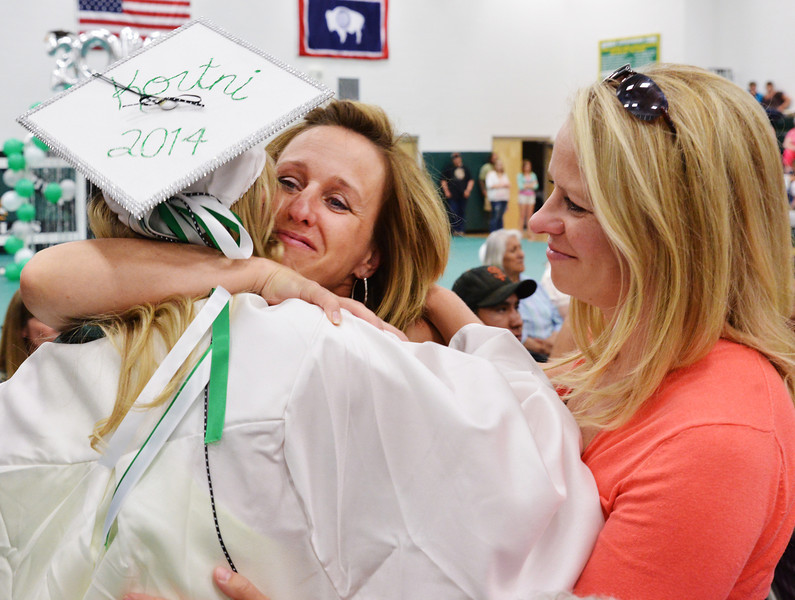 Graduate Kortni Sharp hugs her aunt Karen Green and mother Kirsten Sharp, right, after Kortni received her diploma during the 2014 Graduation Ceremony Sunday at Tongue River High School.