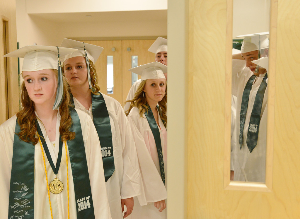 Graduates wait outside the back entrance to the gymnasium before the ceremonies Sunday at Tongue River High School in Dayton.