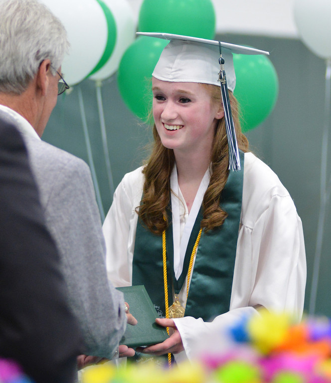 Valedictorian Lydia Allen receives her diploma during the 2014 Graduation Ceremony Sunday at Tongue River High School.