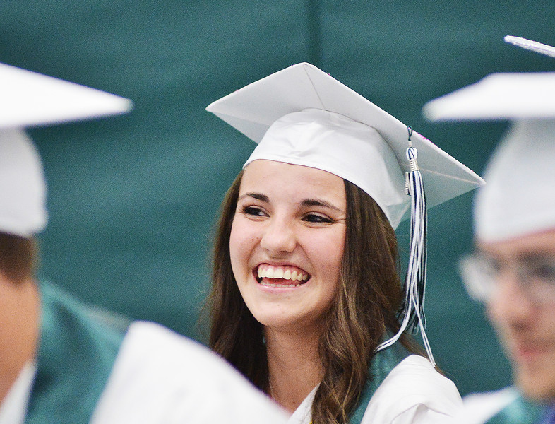 Sarah Rawlings laughs at a remark by the keynote speakers during the grand entrance during the 2014 Graduation Ceremony Sunday at Tongue River High School.